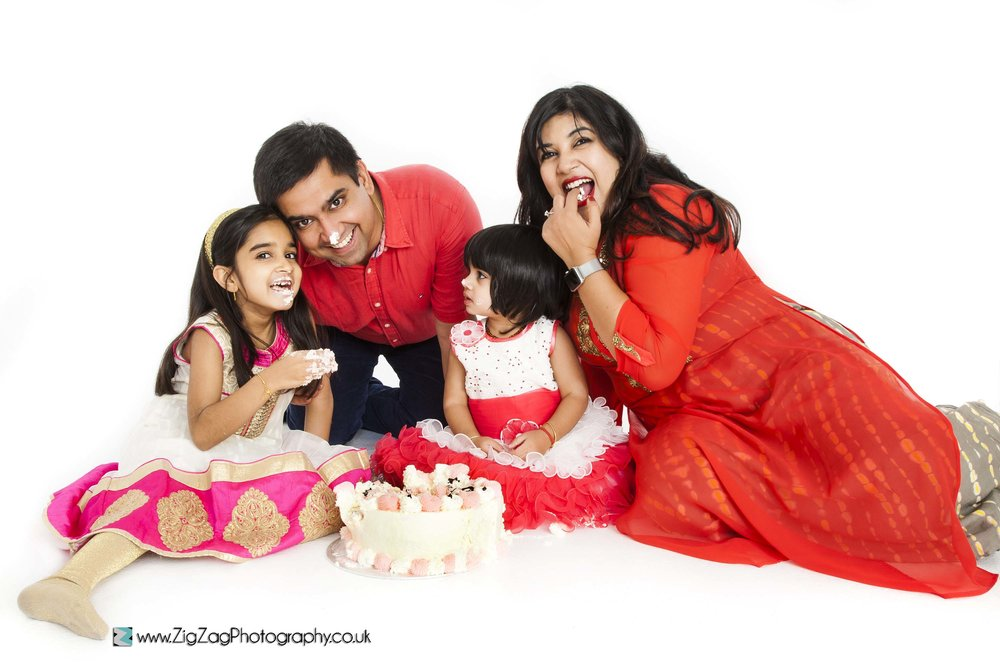 photography-session-leicester-photoshoot-zigzag-cakesmash-cake-smash-birthday-saree-sari-bright-red-fun-different-family-fun-messy-icing-sweet-eat-food-children-parents-girls.jpg