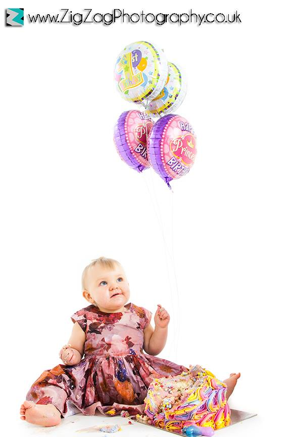 photography-session-leicester-photoshoot-zigzag-studio-cakesmash-cake-smash-baby-birthday-celbrate-dress-rainbow-messy-balloon.jpg