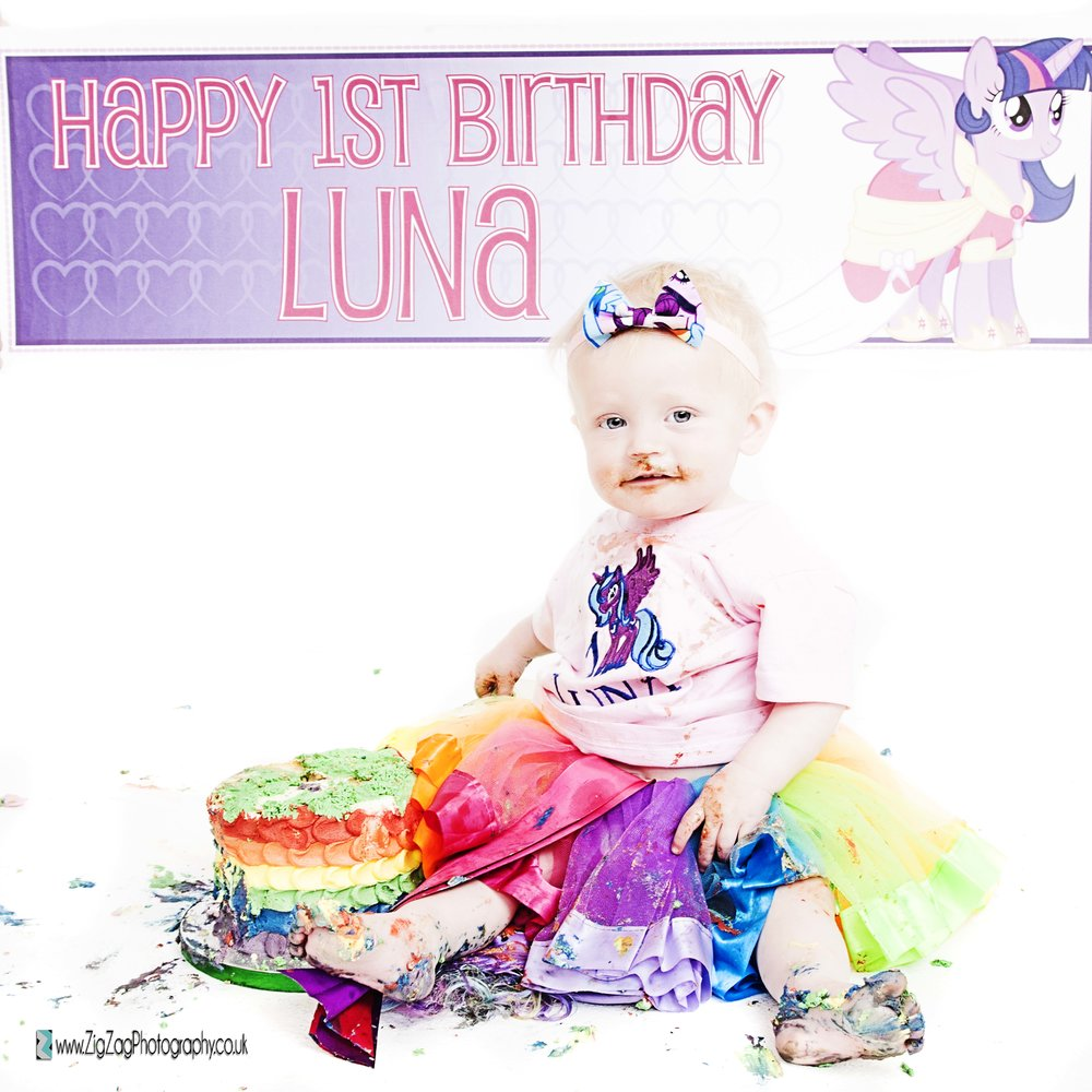 photography-session-leicester-studio-photoshoot-zigzag-cakesmash-cake-smash-colourful-messy-girl-baby-birthday-celebrate-headband-pony-little-tutu-rainbow.jpg