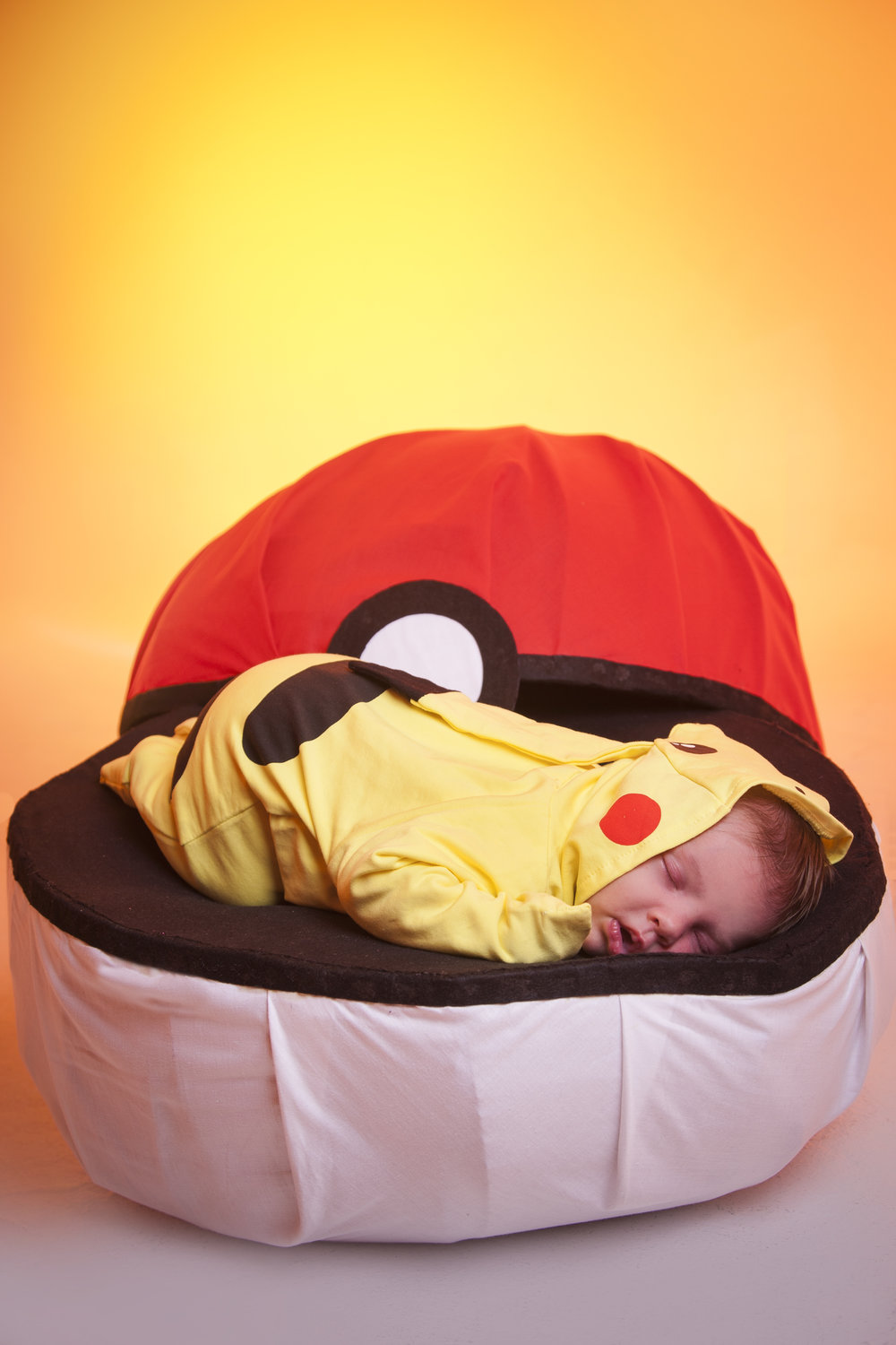 photography-studio-leicester-photo-shoot-photographer-baby-newborn-zigzag-zig-zag-family-clarendon-park-photographer-queens-road-ideas-props-pokemon-pikachu-pokeball.jpg