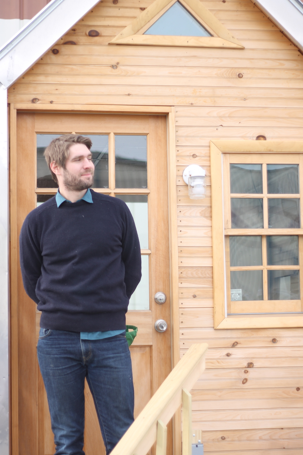 Ecovative CEO Eben Bayer and the company's prototype house insulated with Mushroom Insulation.