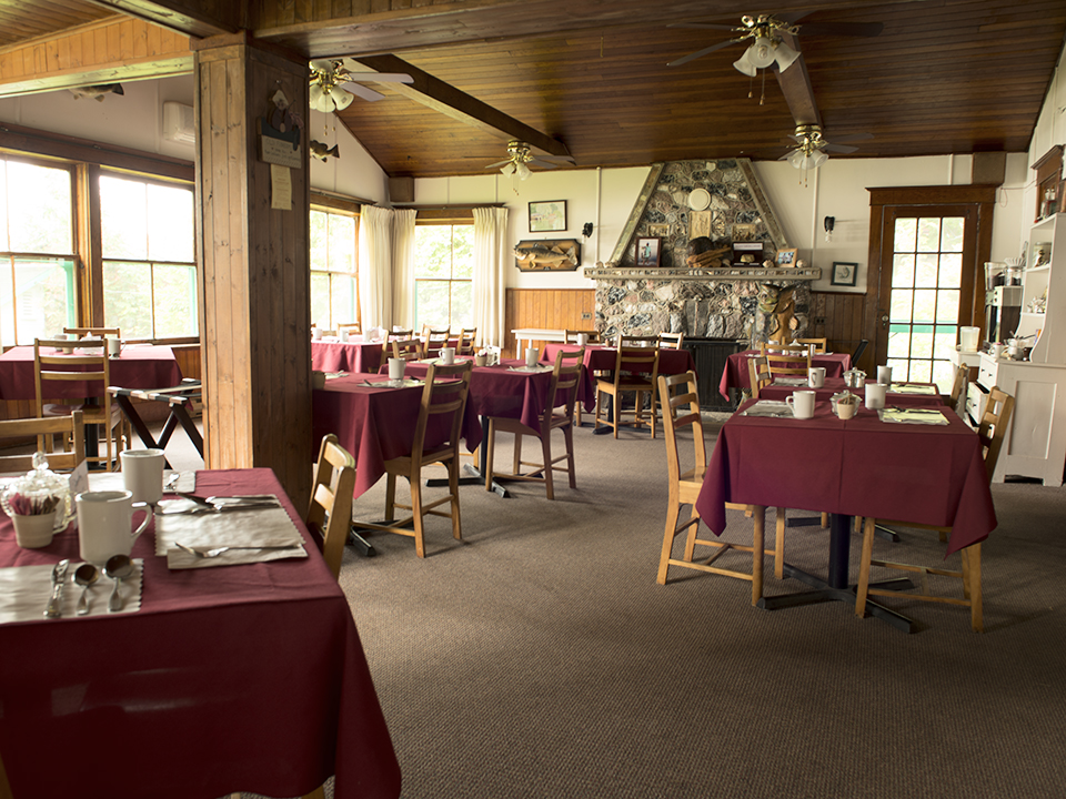 "The dining room is where we serve 3 delicious and hearty meals a day, included with your lodging. For a sample of what we serve, visit the ""2014 Season"" Gallery."