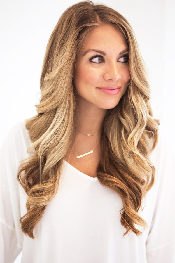 A full down, curled hairstyle goes great with most necklines except a high neckline! -