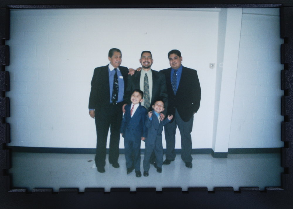 This is me with my dad, uncle, grandpa, and brother. I am the smallest on the right.