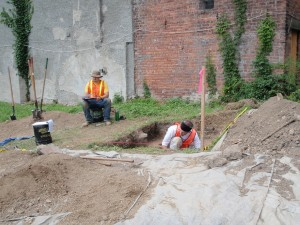 Archaeologists recording soil stratigraphy and measuring depths at 15 Alexander Street.
