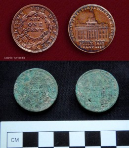 This 1837 Merchant's Exchange Hard Times token (bottom) was found in the clay spoil layer below the Dasch family midden at 15 Alexander Street. An uncorroded example is provided for comparison (top).
