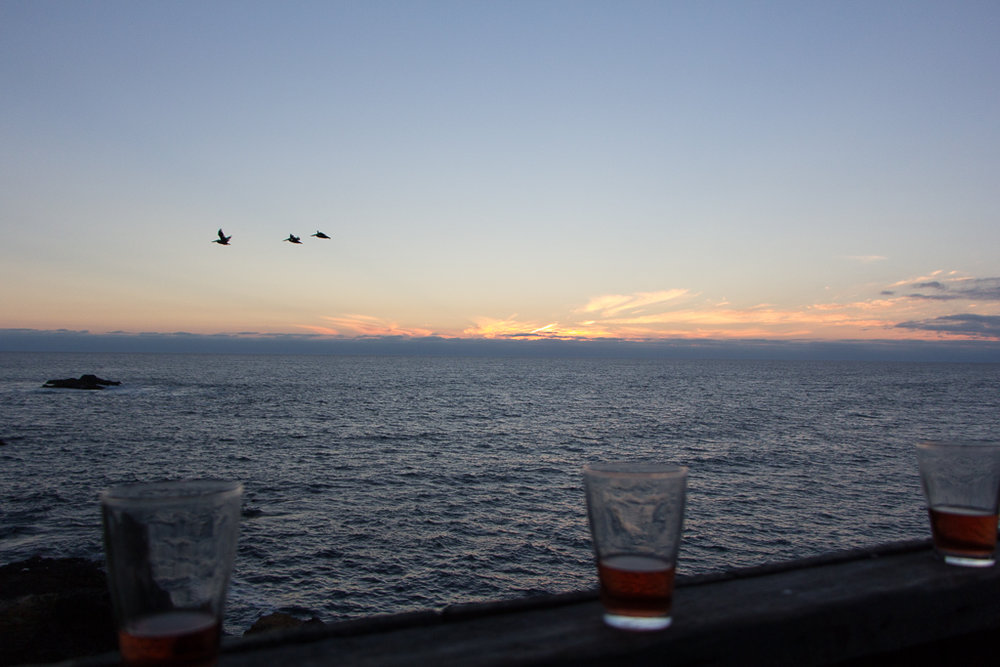Three travelers over the sea, like my ladies and me. Celebrating a spectacular sunset with libations.