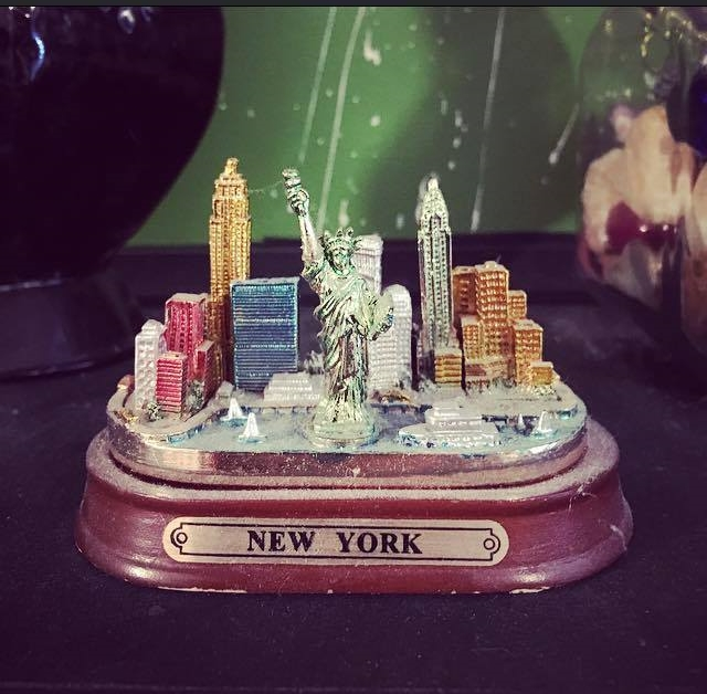My New York figurine, still sitting in my room above my bed