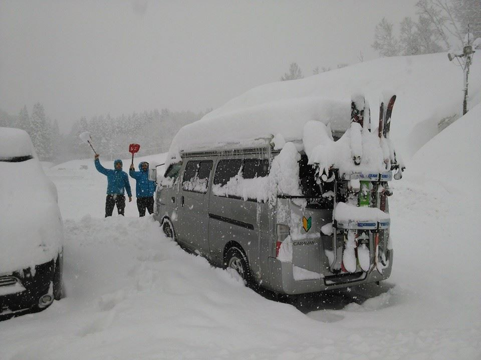 Japan Campers in deep snow with skis