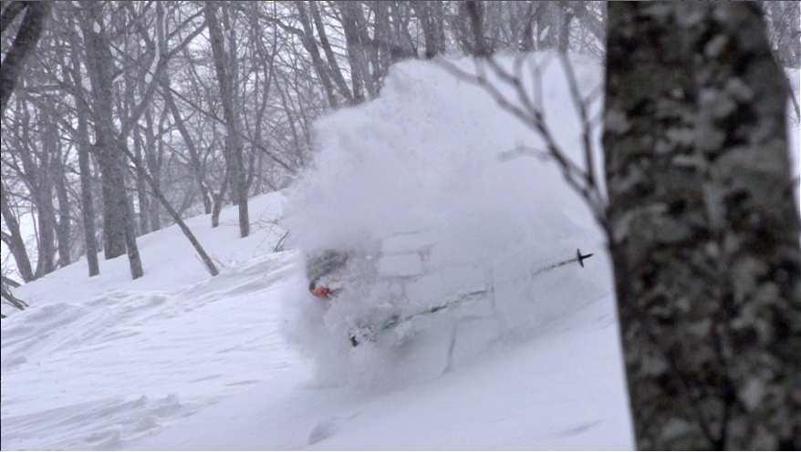 Charlie lands in deep snow at Hakuba Cortina