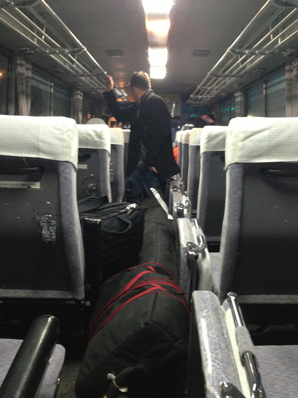 There is room for skis in the aisle of a bus