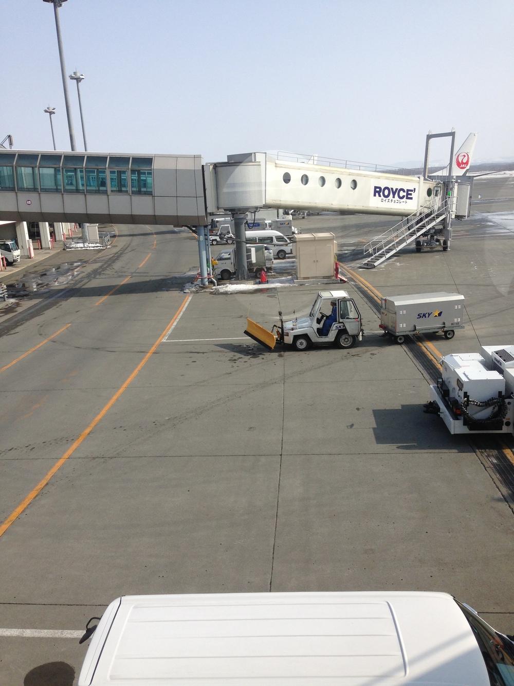 snowplow on airport baggage cart in Japan