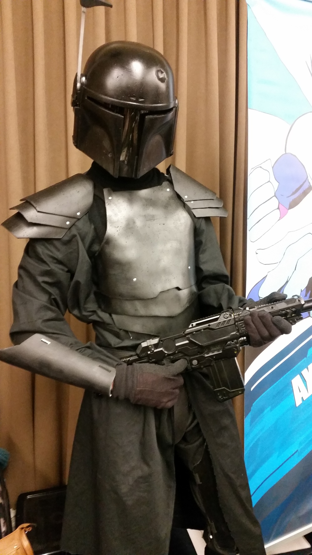 Brenden in the mandalorian armor he made himself.