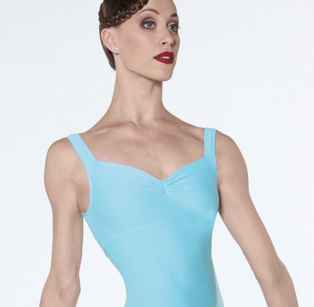 The open neckline and lack of sleeves lengthens the line of the neck and arms, and the light blue stands out without being distracting.