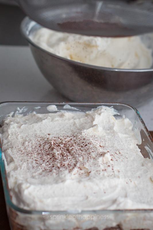 Sprinkling cocoa powder to finish tiramisu