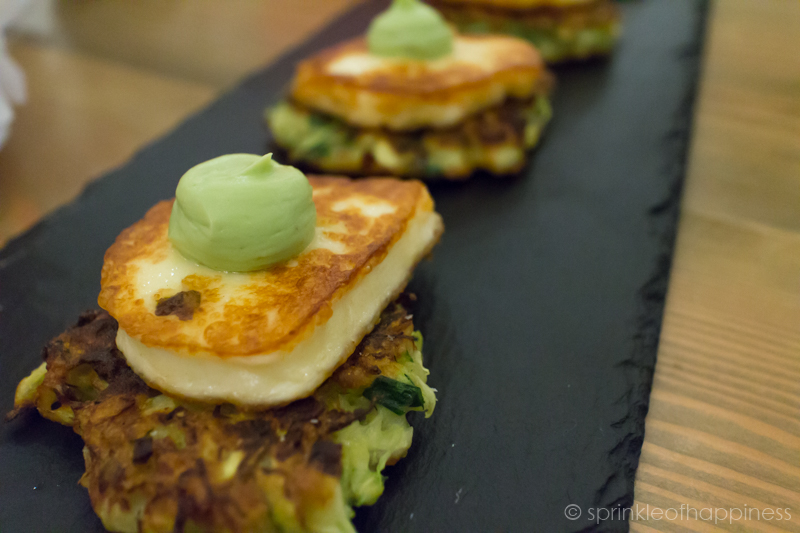 Appetizer - Zucchini, Brussell Sprout Fritters with Grilled Haloumi topped with Avocado Puree
