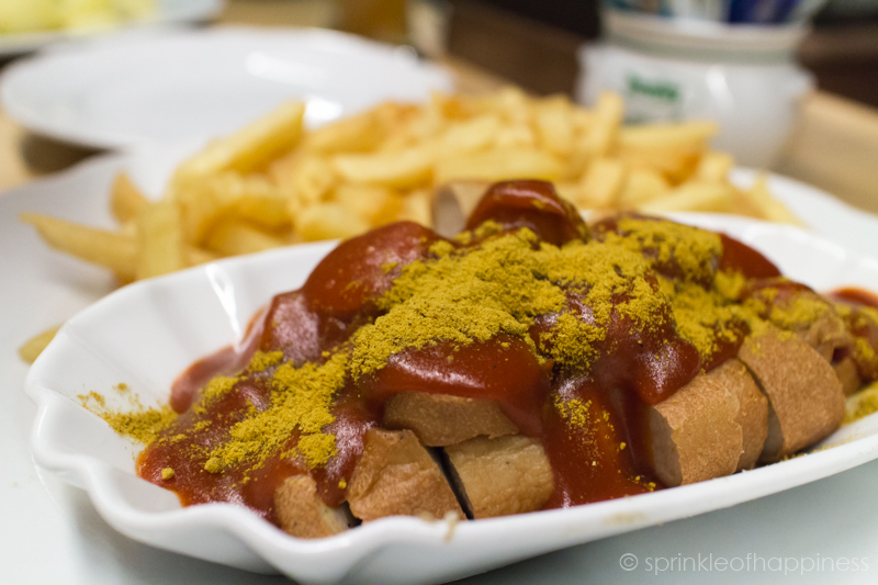 Currywurst with fries - fried sausage with ketchup and curry powder