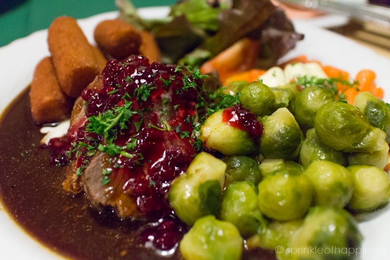Gasthaus Julchen Hoppe - Marinated wild boar in red wine sauce served with brussel sprouts, carrots and potato croquettes