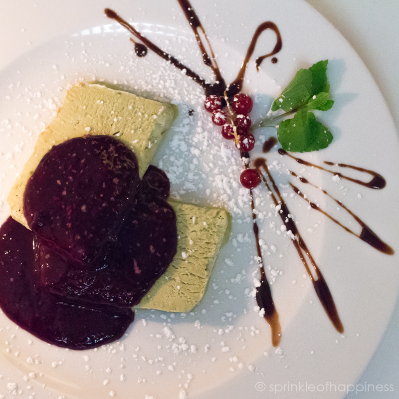 Pistachio parfait with raspberry compote