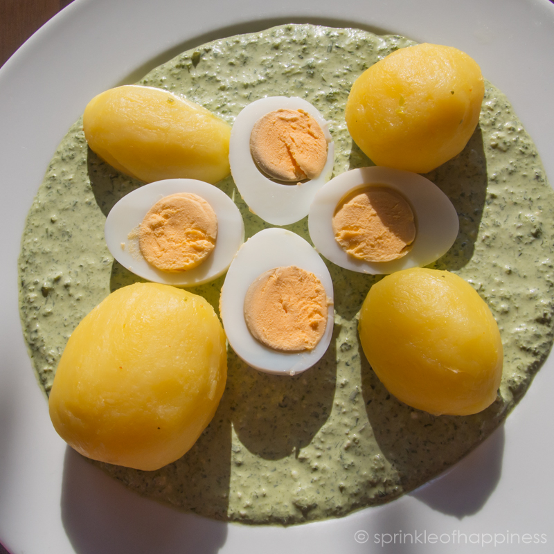 Eggs, potatoes with green sauce