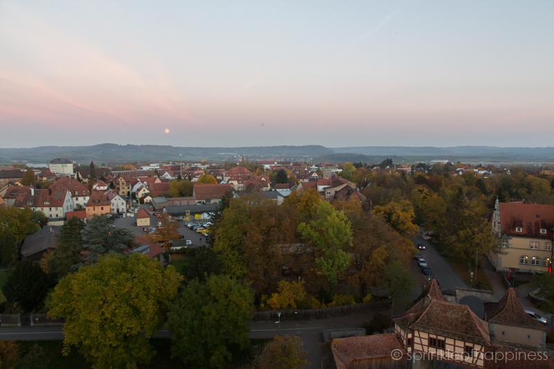 Sunset view of Rothenburg with moon in background