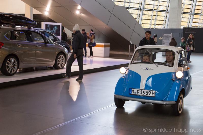 BMW World Showroom - Classic Isetta being driven around
