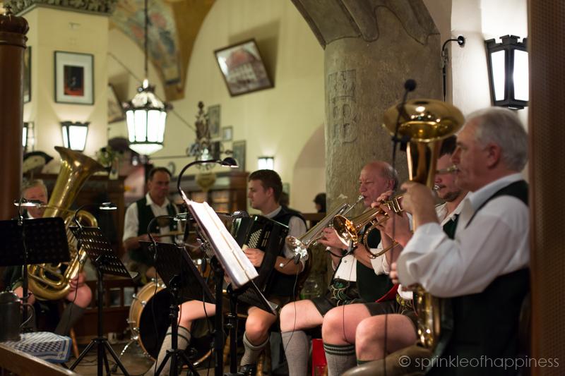 Inside Hofbrauhaus Munich - gentlemen in Lederhosen playing live music for the evening