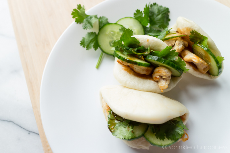 Open-faced steam bao stuffed with pan-fried chicken, pickled cucumber, cilantro and dressed with a lime, sriracha, and hoisin sauce.