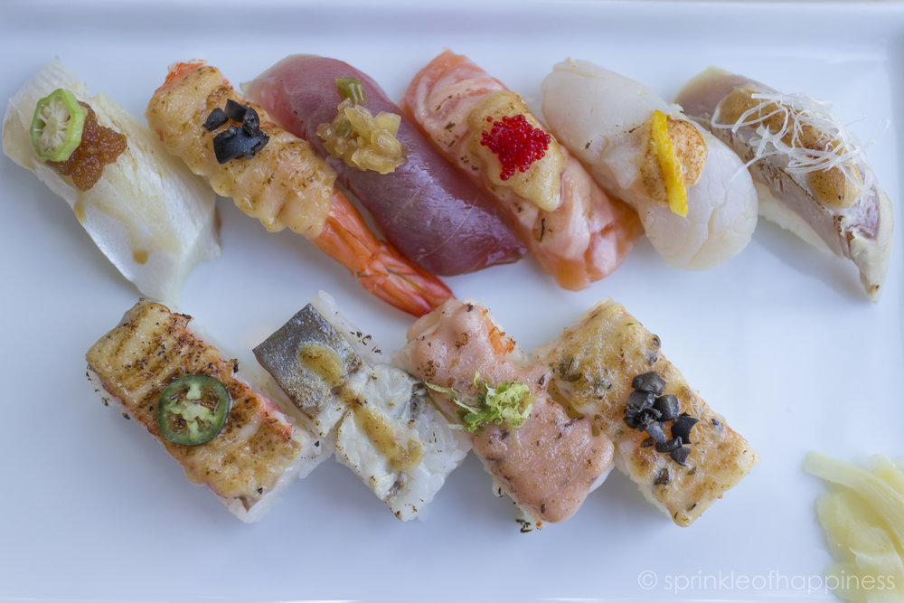 Top (left to right): hamachi sushi with okra, truffle shrimp, tuna sushi, salmon with mayo and roe, scallop sushi, aburi albacore.  Bottom (left to right): salmon oshi with jalapeno, saba oshi, shrimp mayo and a truffle shrimp oshi sushi.