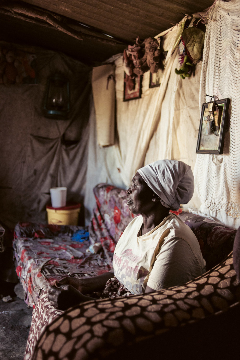A woman sits on her couch in a refugee camp in Kenya. Love Volunteer project 2015.
