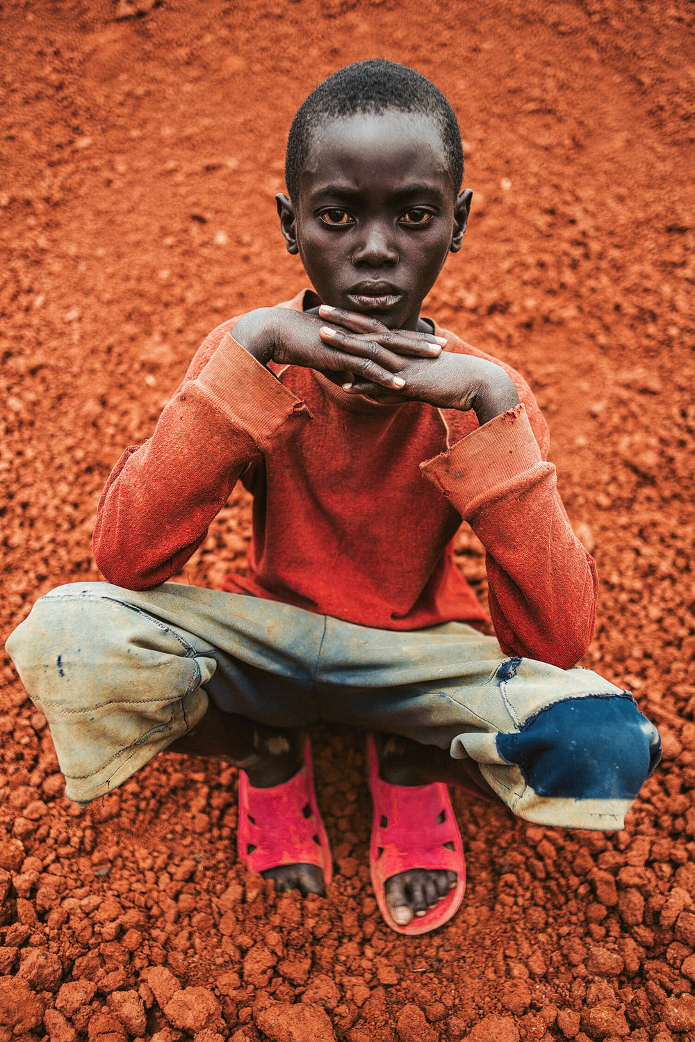 A boy outside his home in Rwanda. Love Volunteer project 2015.