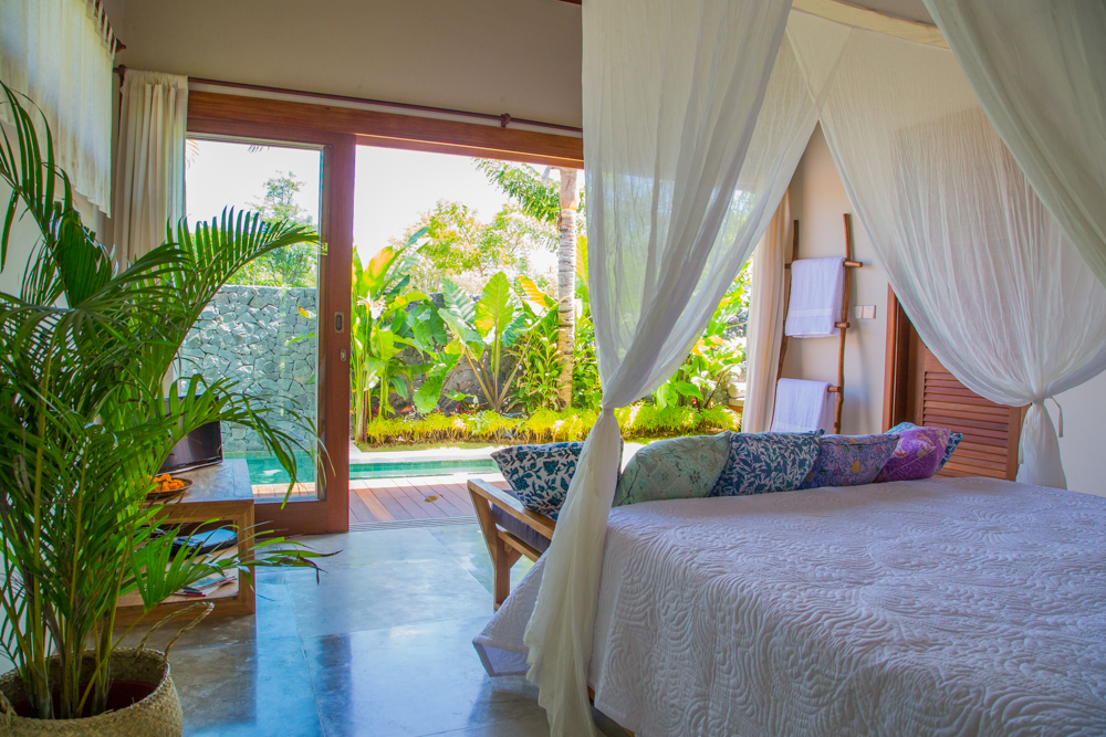 Your king size bed overlooks your own garden and pool
