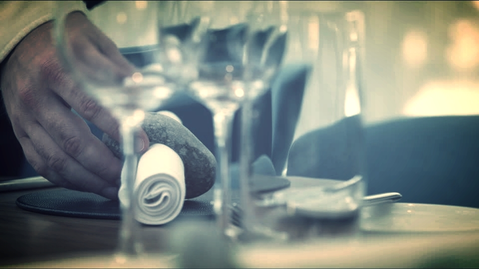 986988554-table-setting-process-napkin-table-setting-place-water-glass.jpg