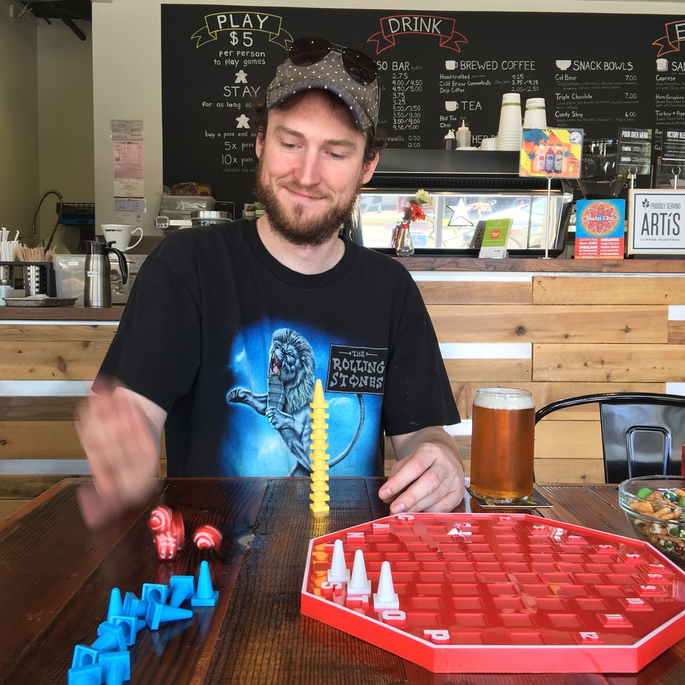 Brandan Parsons of Blue Orange Games playing at Victory Point Cafe