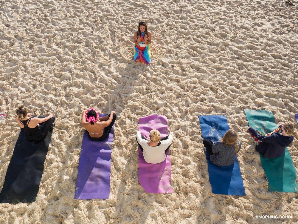 The Bondi Mermaid teaching yoga