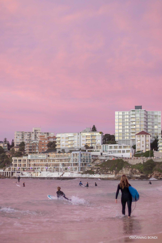 Surfing at dawn