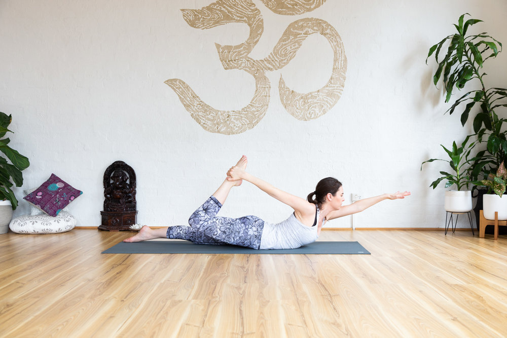 Half bow pose. Extend left arm in front. Right arm to right ankle. 9x