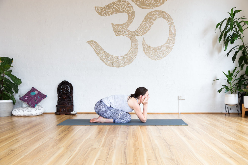 Supported childs pose. Keep the chin rested in the palms to prevent over straining of the back.