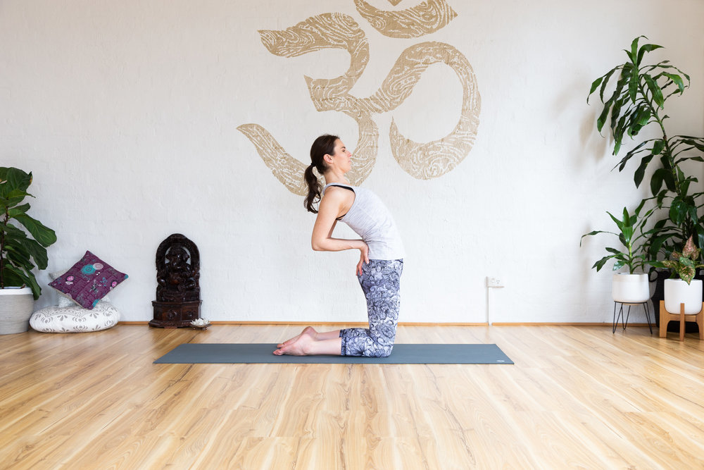 Camel pose. Keep butt, thigh and core on. Push hips forward, lean from upper back. 5-9 breaths.