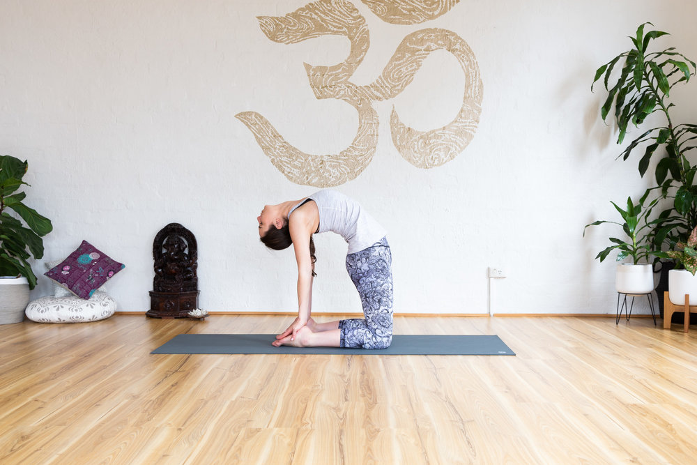Push hips forward, exhale to lower head. Hold 5-9 breaths. Inhale to come up.