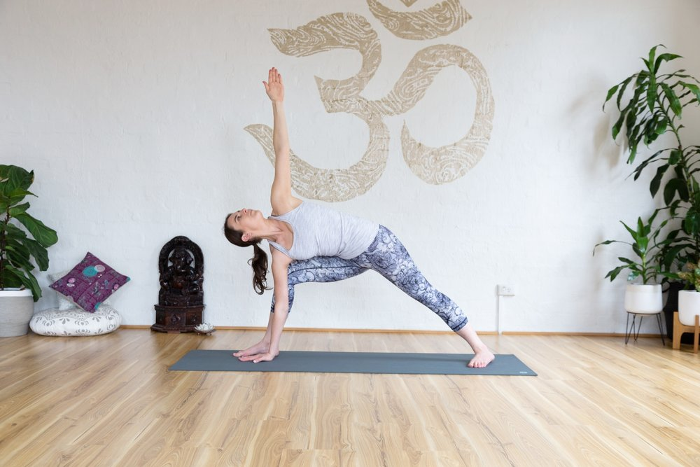 Side ankle pose. Reach top arm high toward the sky. Hold 5-9 breaths.
