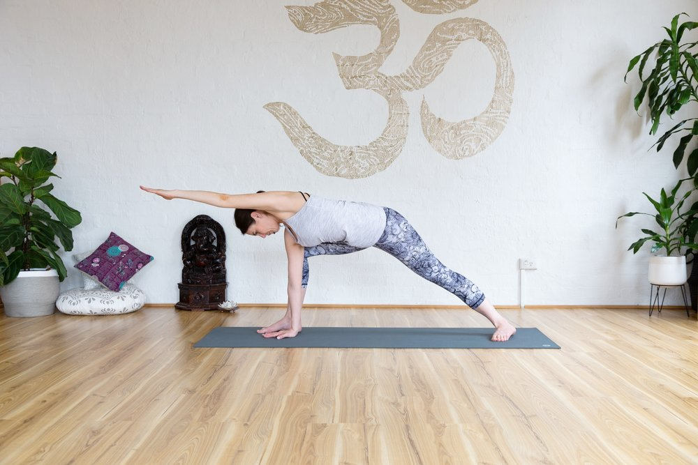 Side angle pose variation. Rotate through shoulder and hips to find your deepest stretch. Hold 5-9 breaths.