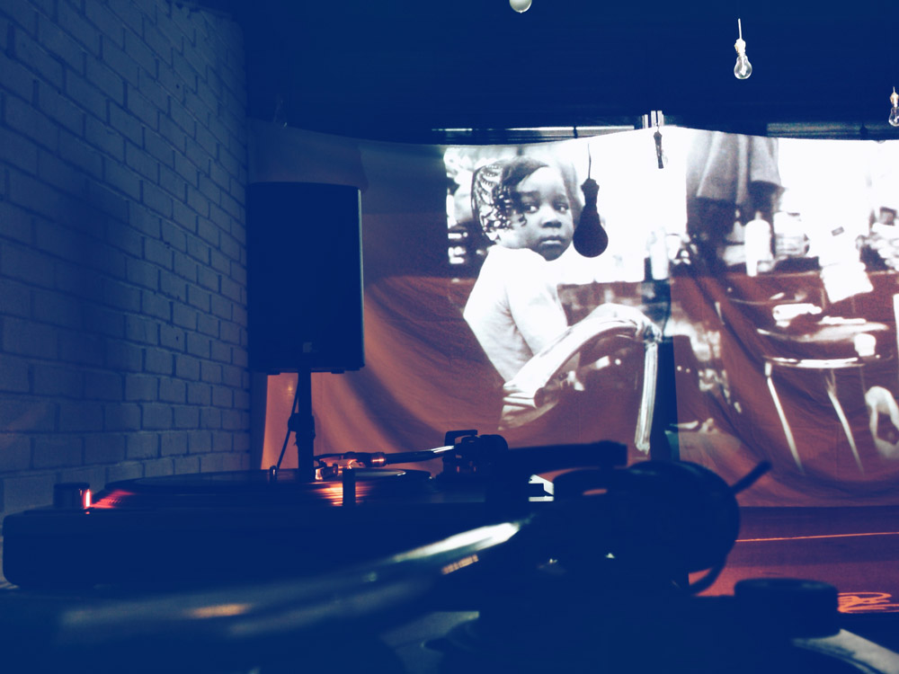 Image from Adamah Jalloh's Identity collection projected onto the 'shop window' at the event