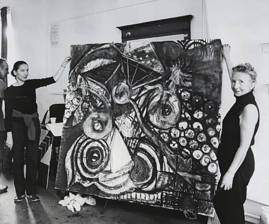 Molly Beck, my mother (on the right) holding a charcoal drawing