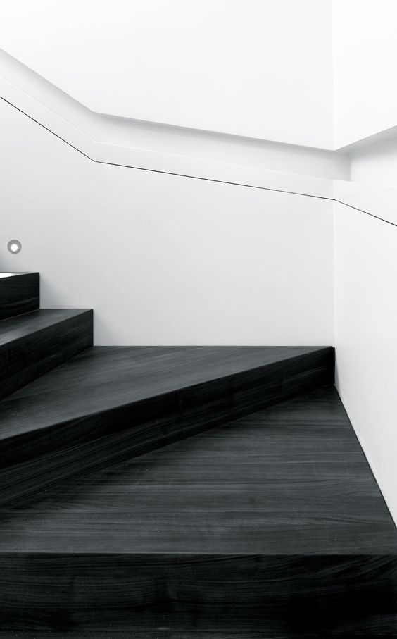 Bold stairs in dark timber with beautiful details that are to die for.