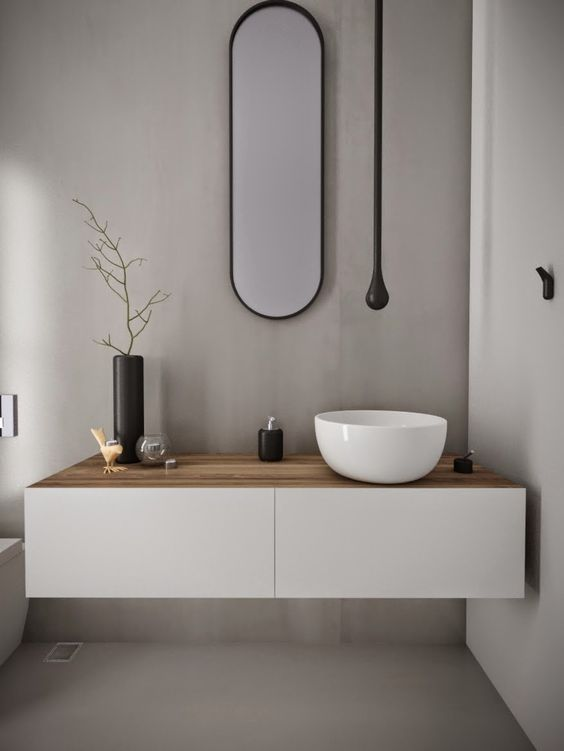 oval shapes create a less conventional bathroom. thin edges and lines with beautiful seamless design
