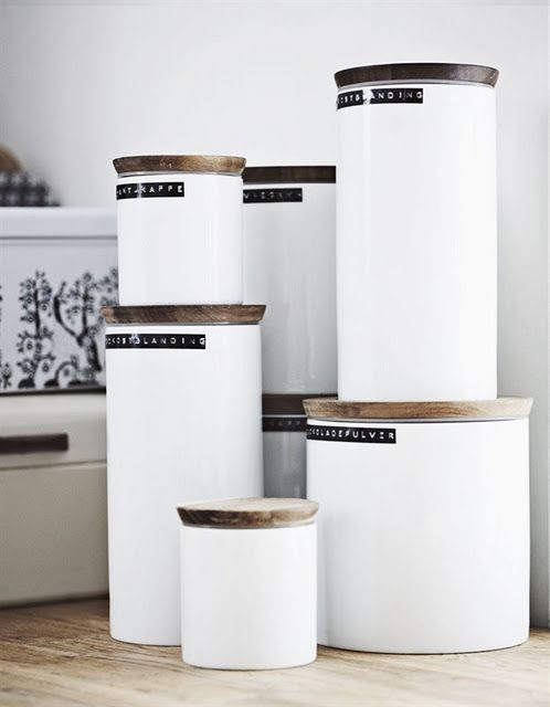 Lables - simple yet effective.  No one said you had to have clear containers.  Go white.  There's something timeless about black labels from the old label maker.  Think 1950s office filing systems for your kitchen.