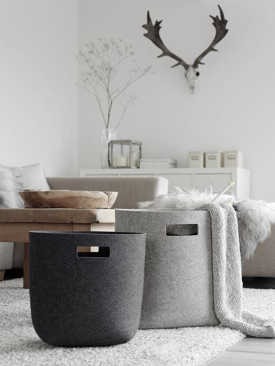 Add some baskets in the living room for winter throws or bits and pieces that find their way into your living space.  They're' handy when a quick clean up is in order.
