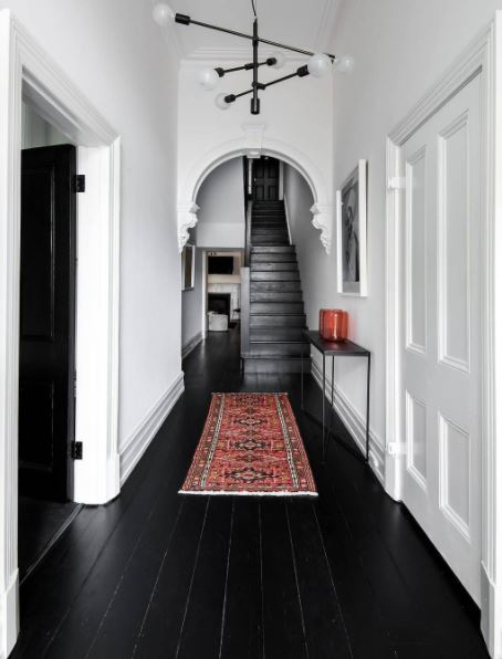A Timeless and well executed interior, yet convincing clients to use black flooring and white walls isn't as easy as you would expect.  This stunner reeks of style.  Bold and beautiful.