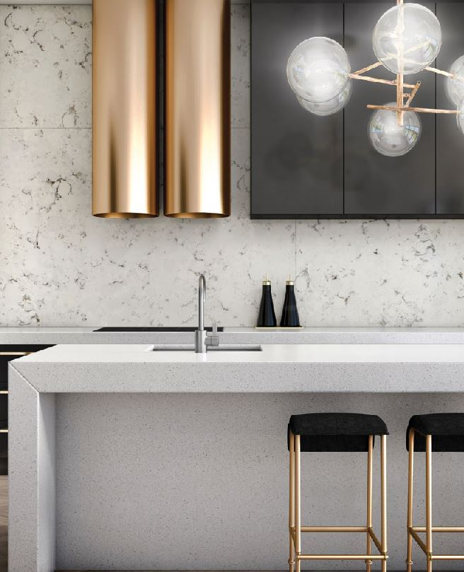 Its a simple as Brass, stone and black joinery.  Proportion is everything sometimes.  Custom stools and the range hood are things that make you go ooooh!